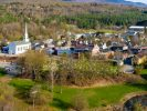 Stowe, Vermont in the spring. This aerial view was taken in early May. The daffodils had only just started to come up, the buds in the trees were just visible. Only the grass is green. Most everything else in this tourist town in northern Vermont is still brown!